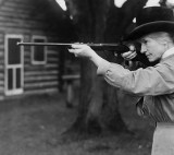 1922 - Annie Oakley taking aim