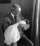 1915 - Woodrow Wilson with his new grandson