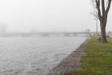Looking down the Moira River on a foggy morning towards Dundas Street bridge