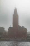 Belleville City Hall in fog across the Moira River