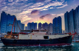 Trawler returns to the Typhoon Shelter at sunset