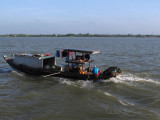 A Unique Boat on the Mekong