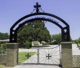 Sacred Heart Catholic Cemetary entrance looking toward the church.