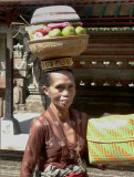 Older lady carrying temple offerings, Mengening