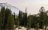 Smoke creeps up to Clouds Rest Peak (9926 ft.) from the Yosemite Valley along the Tioga Road in Yosemite National Park
