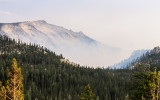 The valley below Clouds Rest Peak fills with smoke as seen from along the Tioga Road in Yosemite National Park