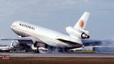 1979 - National Airlines DC10-30 N83NA smoky touchdown upon landing at Miami International Airport aviation airline photo