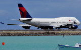 2010 - Delta Air Lines B747-451 N671US taxiing out for takeoff on the reef runway at Honolulu International Airport
