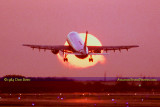 1984 - Eastern Airlines Airbus A-300 taking off in front of the setting sun at Miami International Airport
