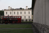 A red bus passes Queen's House in Greenwich