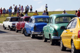 Cars parked at El Morro - taxis, classic American car taxis, Russian Ladas