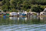 Houses along shore near Bay of Jagua soon after leaving Cienfuegos