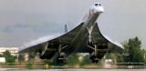 1990 - British Airways Concorde G-BOAA with condensation on top of the delta wing landing on runway 30 at MIA