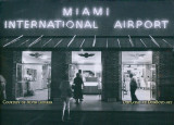 1957 - Entrance to the 36th Street Terminal at Miami International Airport at night with neon lighting