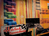 June 2017 - wallpaper memorial to Hialeah Speedway inside the restroom hallway at Applebee's in Hialeah