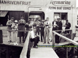 1920-1924 - Aeromarine Airways staff members dining on ice cream from an unclaimed flight shipment