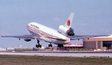 May 1979 - National Airlines DC10-30 taking off on 9L at Miami with National's headquarters and maintenance base on the right