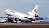 1979 - DC10-30 N83NA smoky touchdown upon landing way down runway 27R at Miami International Airport