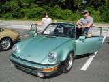 Rachel and Jim with their 1977 Porsche 911 Turbo Carrera (930) in Ice Green Metallic (3672)