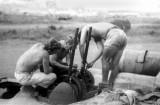 B-24 Top turret gun maintenance ~ Papua New Guinea  1943+
