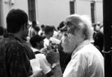 Man drinking with straw at Mardi Gras