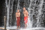 Monks Showering in Mountain Waterfall