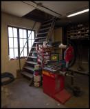 Stairway to the attic and wheel balance machine