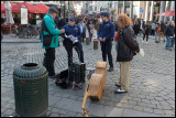 Street musicians in Brussels have to pay fines to the police