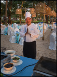 Our chef preparing evening dinner at the beach