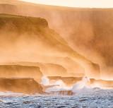 Misty Cliffs at Sunset