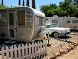 Home With White Picket Fence And Cool Cadillac