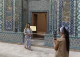 Posing with art at Shah-i-Zinda, Samarkand