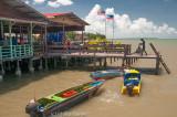 Fishermen offload their catch at a seafood restaurant, Kampong Buli Sim Sim