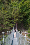 Our hostess Nelly pauses on a suspension bridge