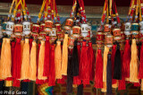 Colourful tassels decorate a selection of Buddhist prayer wheels