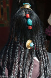 A woman visiting the Norbulingka shows off her hair