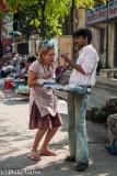 Tourist meets local vendor