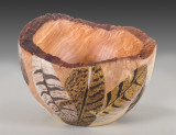 Bowl with feather carvings.