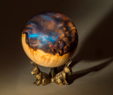 Maple Burl with Acrylic resin turned into a sphere.