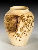 Paul turned this vase and collaborated with Joanne Sauvageau for the pyrography.