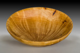 Burch burl bowl with beautiful pattern in the rays comming from the wood.
