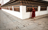 Young Monk and Prayer Wheels