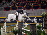 McLain Ward riding HH Gigi's Girl over oxer at the McKee Family International Jumper Competition at the Royal Horse Show Ricoh C