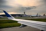 Jet airplane taking off on runway at Pearson International Airport at sundown Toronto Canada