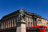Statue and monument to visit of King George IV to Scotland in 1822 with red bus in George Street Edinburgh Scotland UK