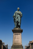 Bronze sculpture of William Pitt the Younger a British Prime Minister on George Street Edinburgh Scotland with blue sky