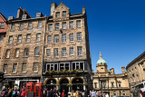 Crowd of tourists and historic highrise stone buidings on the Royal Mile in the Old Town of Edinburgh Scotland UK