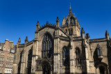 West facade of St Giles Cathedral with crown steeple in Parliament Square on the Royal Mile Edinburgh Scotland UK under blue sky
