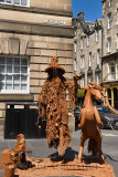 Levitating wizard dressed in snakes and lizards street performer on Lawnmarket on the Royal Mile Edinburgh Scotland UK