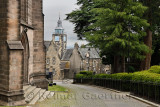 Road at Church of the Holy Rude leading to Stirling Boys Club and The Tolbooth clock tower on Castle Hill Stirling Scotland UK